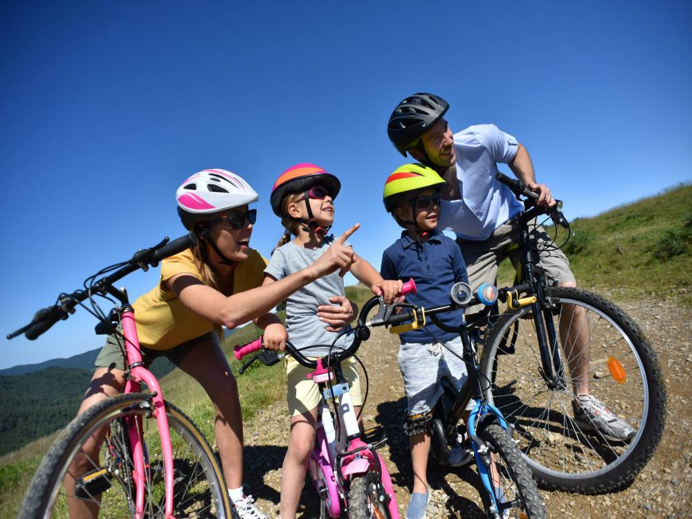 Family of 4 exploring bike trails