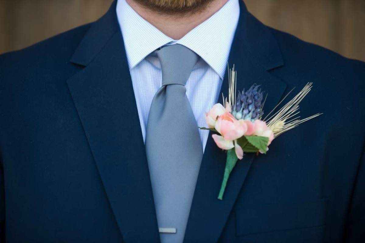 Navy blue tuxedo with a small pocket bouquet