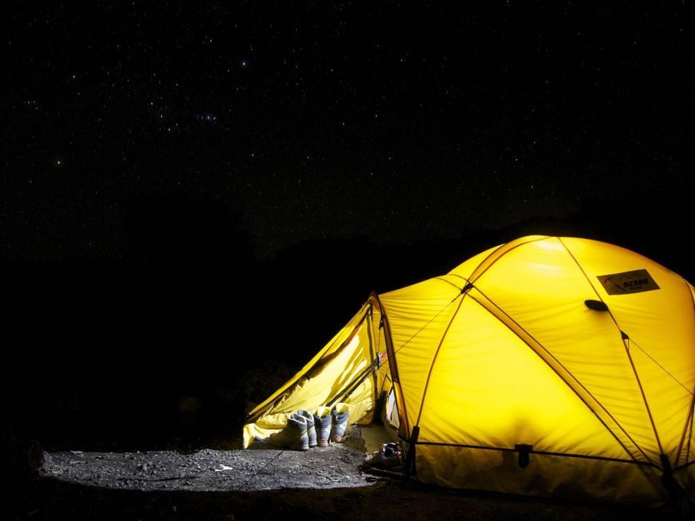 yellow tent at night